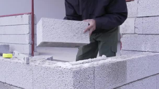 worker building wall