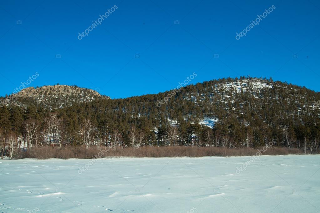 Snow mountain. Winter landscape. Kazakhstan national park Burabai ,Borovoe