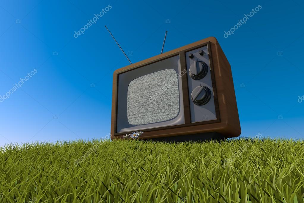old antique wooden TV on grassy hill