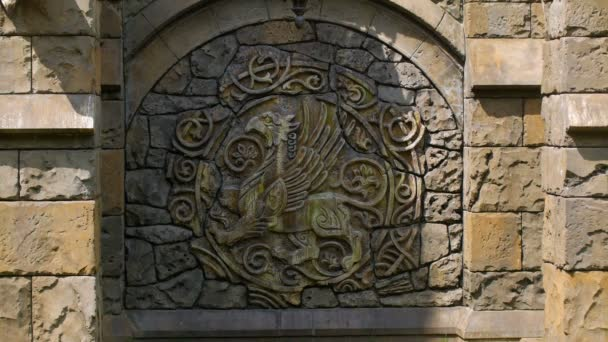 bas-relief of coat of arms on wall of medieval castle