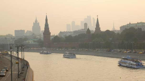 tourist boats are floating on river near Moscow Kremlin in sunset time