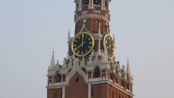 Kremlin clock on Spasskaya Tower in sunset, on sky tightened smog, close up
