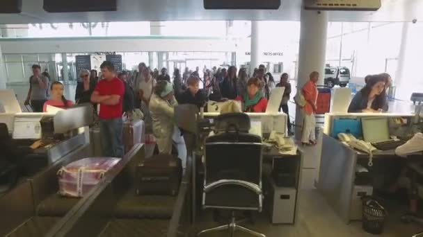 camera moves through the check in desk