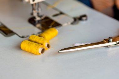 Bobbins of yellow thread