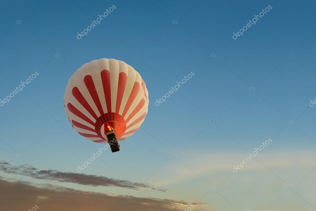 A hot air baloon rising high