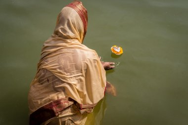 Hindu woman makes and Aarti offering