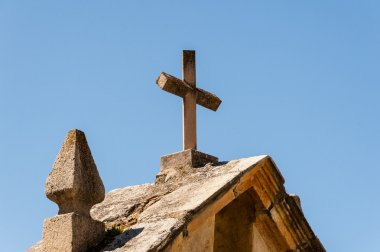 Cross on top of ancient water well