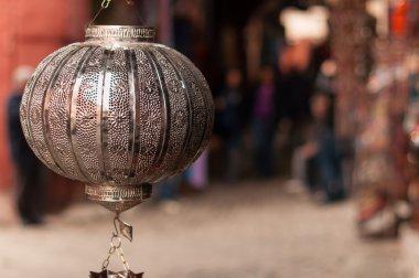 Metal lampshade hanging outside