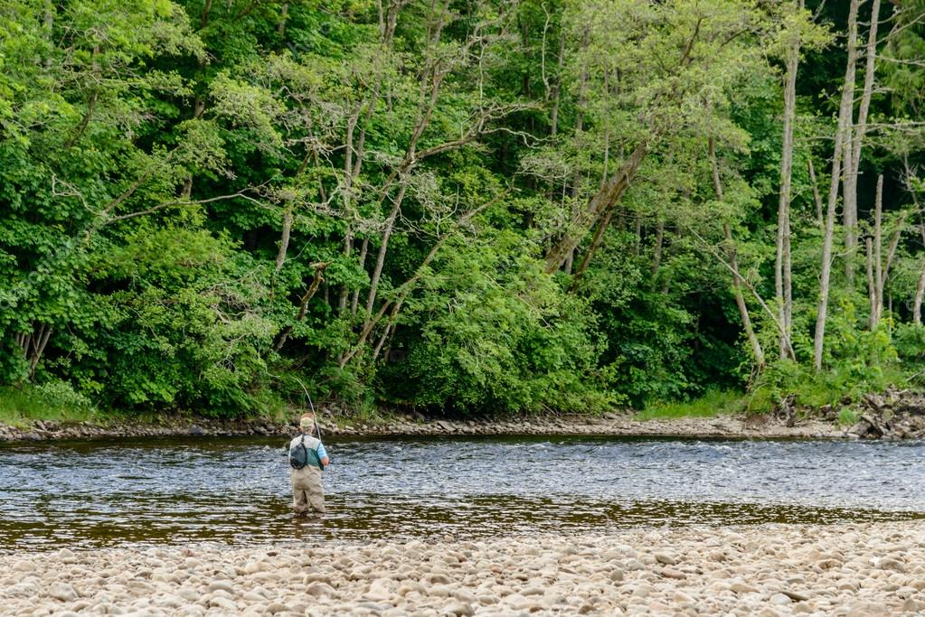 Unidentified man fly fishing