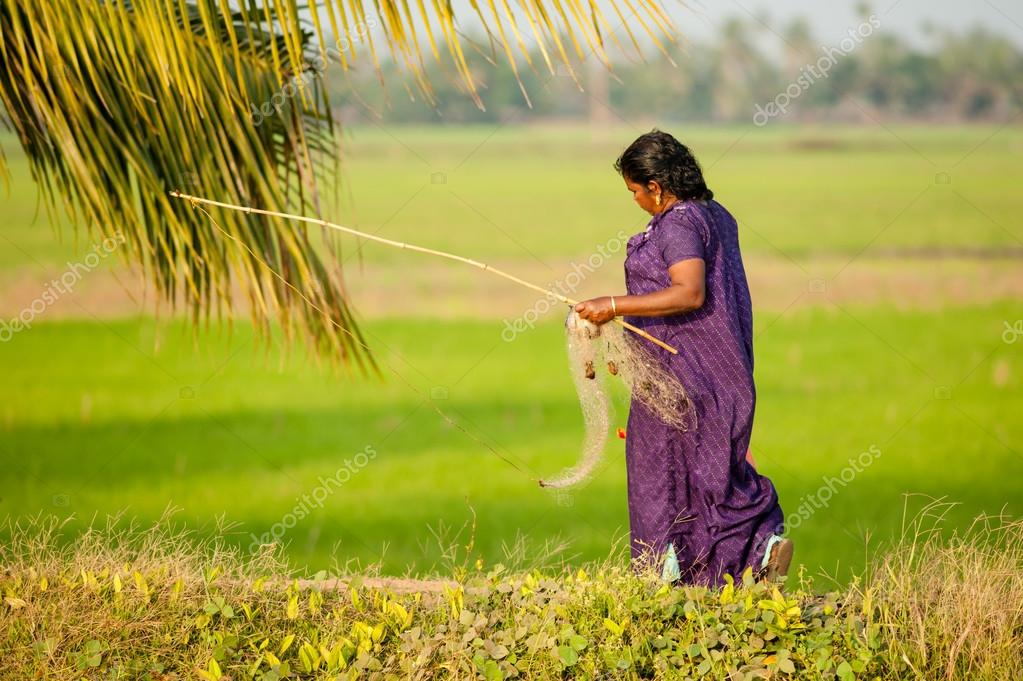 A woman heading home after fishing
