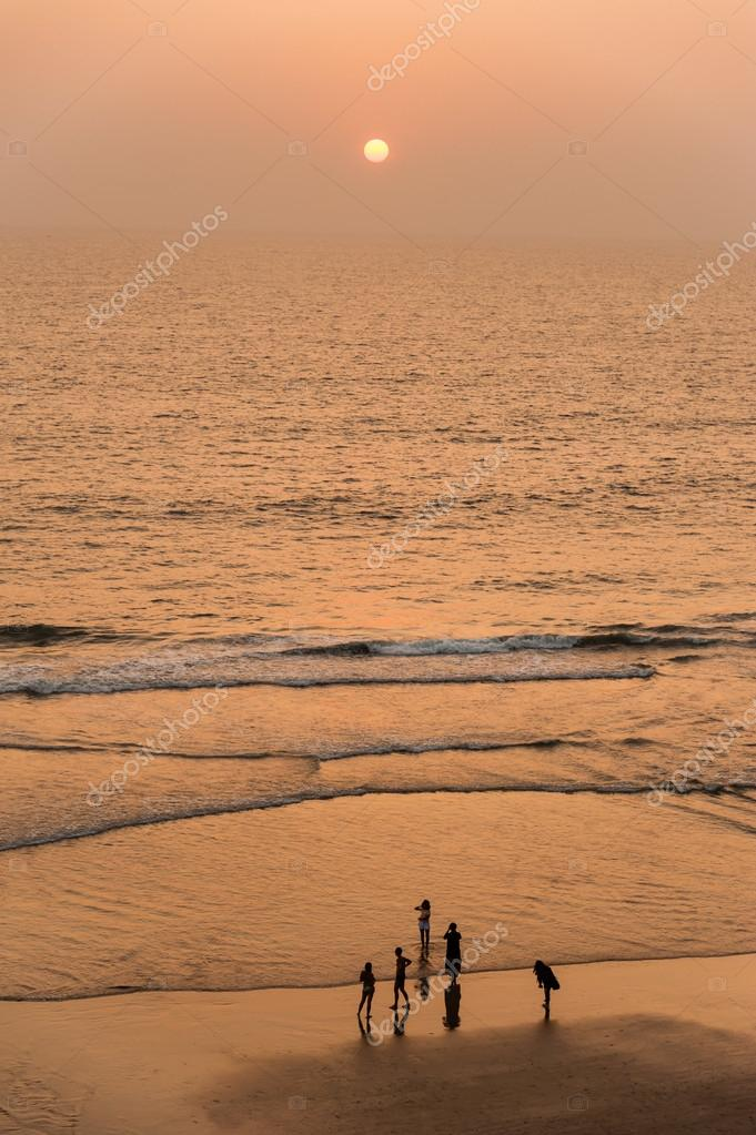 People walking along beach