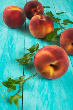 Peaches on turquoise table
