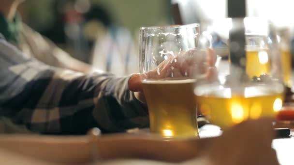A fun company is drinking beer at the bar