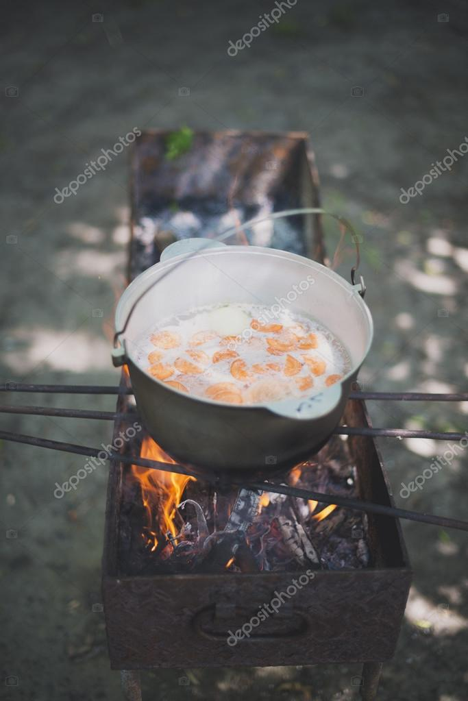cauldron with fish soup