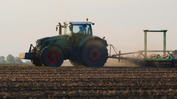 The tractor works in the field. planting