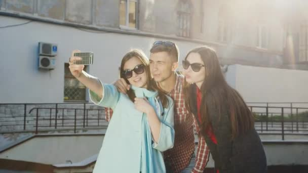 Hipster friends are doing selfie. Laugh, make funny faces.