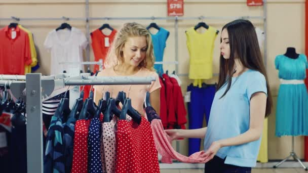 Start a successful shopping - friends coming to stand with clothes