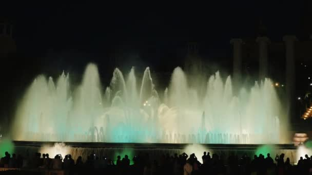 Barcelona, Spain - June 15, 2016: Many people watch the show of glowing and singing fountains