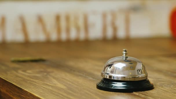 hand strikes the bell at the reception or in stores