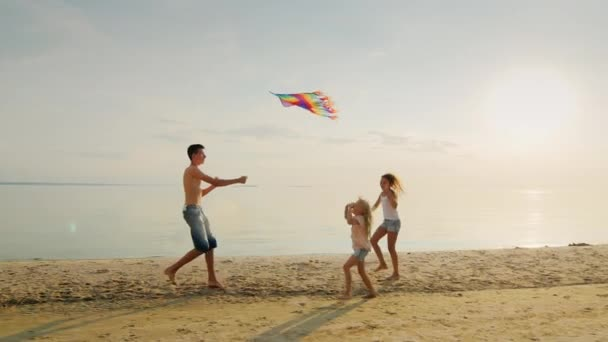 Carefree children play together. The elder brother entertains younger sisters kite