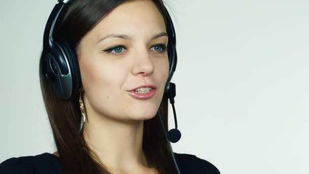 Female call center operator on white background