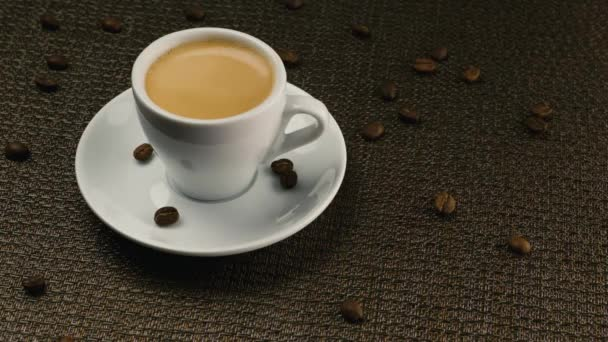 A cup of espresso on a dark background