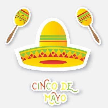 Mexican sombrero hat, maracas.