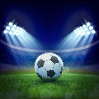 Soccer ball laying on stadium