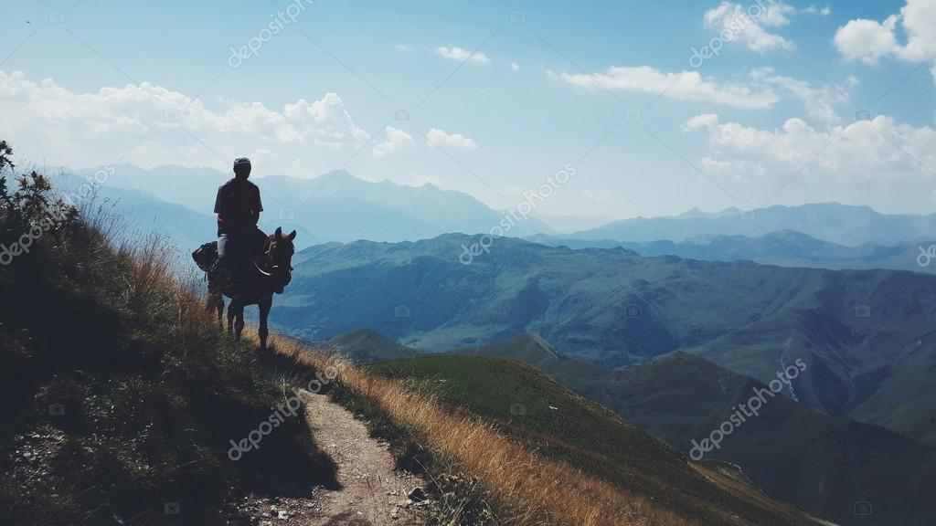 Man riding the horse in mountains