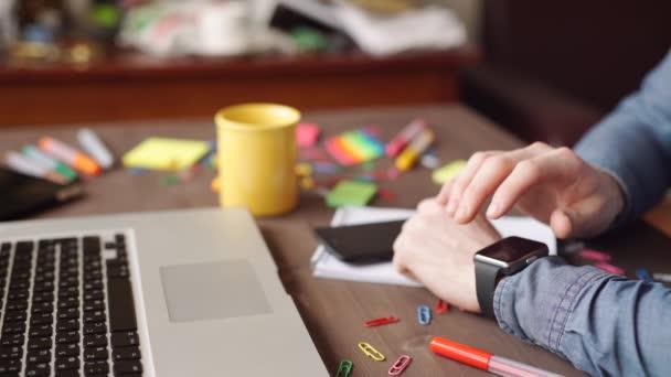 Website designer working with smart watch and digital tablet and digital design diagram on wooden desk as concept