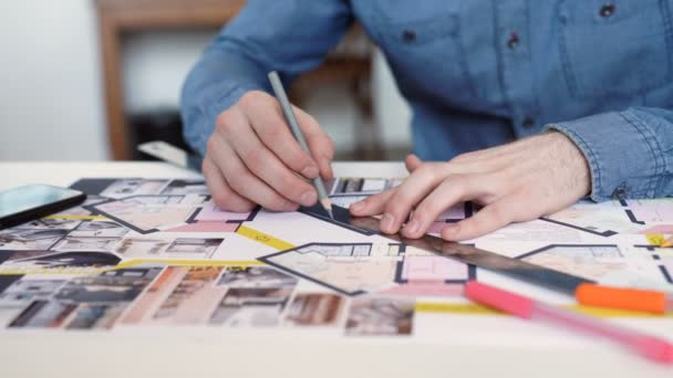 stylish architect working on blueprint