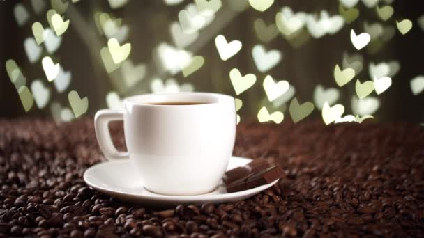 white cup on the coffee beans on the background of hearts
