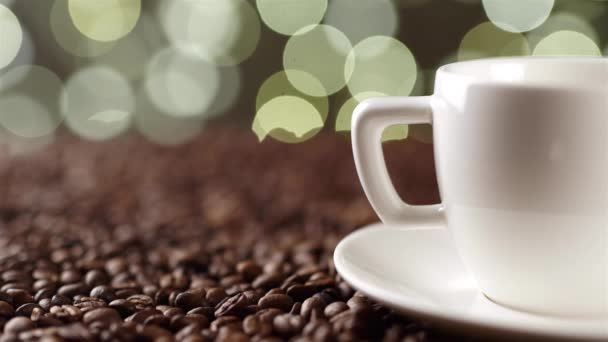 white cup on the coffee beans on the background of lights