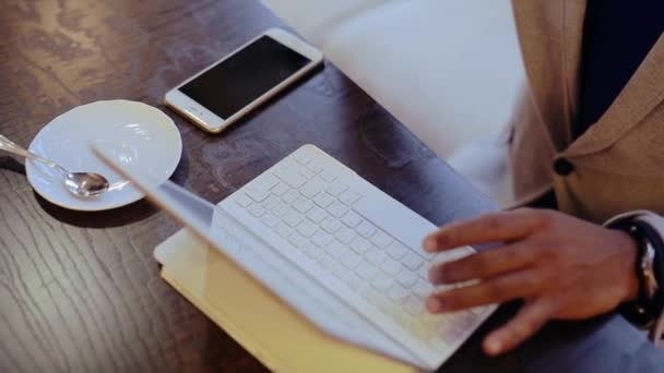 Handsome black man using laptop