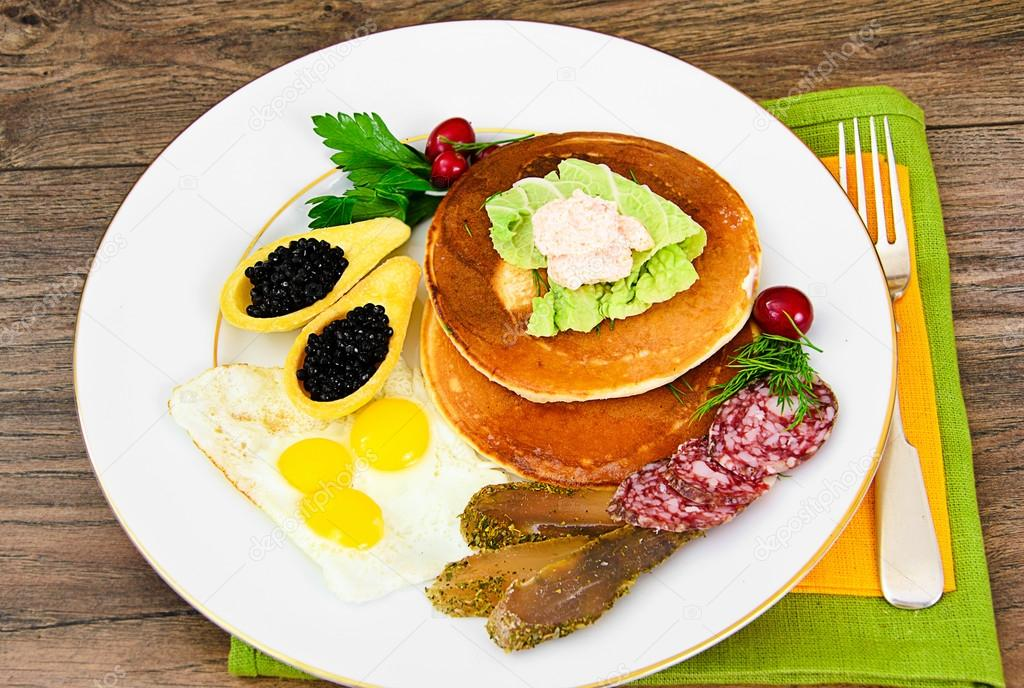 Pancakes with Quail Eggs, Cold Meats, Pastry Spoon with Black Ca