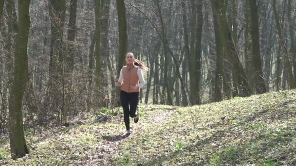 Sexy girl running in the woods. Slow motiom