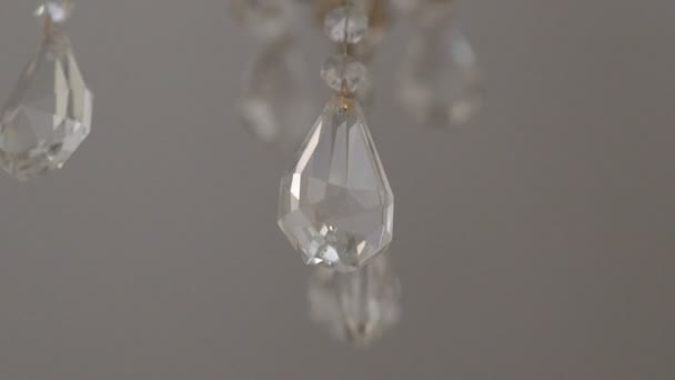 Crystal detail of a glass chandelier. Slow motion