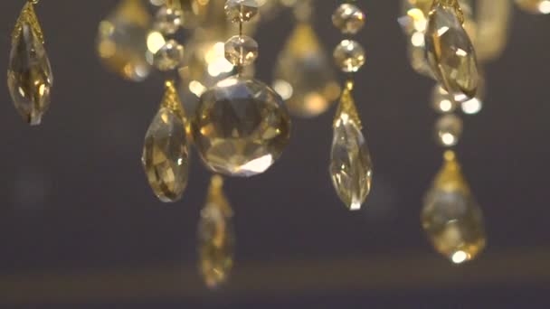 Moving of a luxury crystal gold chandelier. Beautyful background. Slowly
