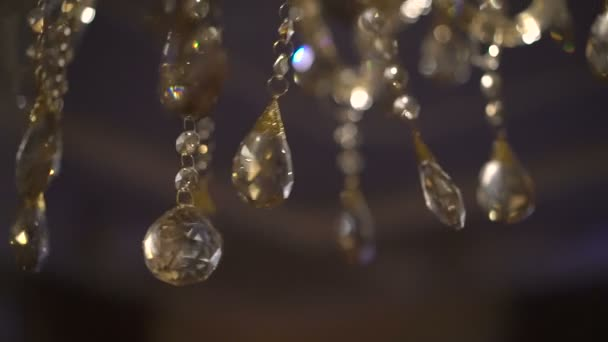 Moving of a luxury crystal chandelier. Beautyful background. Slowly
