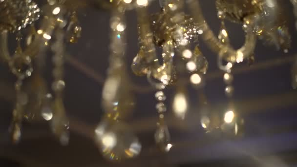 Incredible chandeliers glowing on a dark background. Slow motion