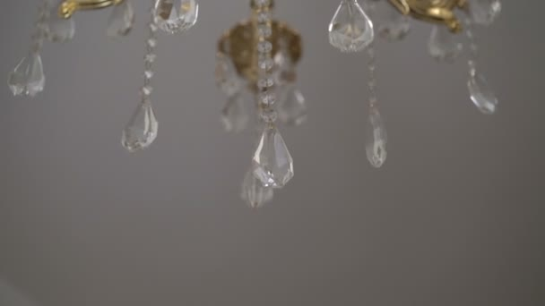 Crystal classic chandelier detail background. Crystals close up. Slowly