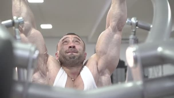 Strong world champion doing exercises for arms, big biceps