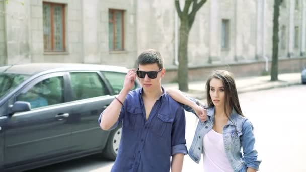 Young couple posing sideways on the street. 4k