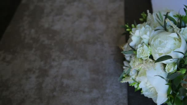 Beige wedding bouquet with roses and peonies
