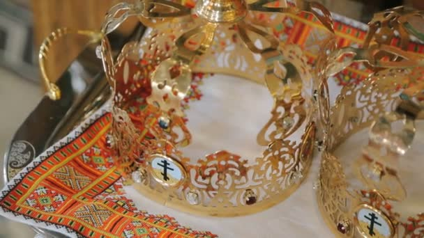 Close up of two wedding crowns prepared for ceremony of marriage in a church