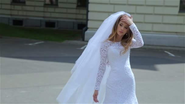 bride walking in the park wind dispels her hair