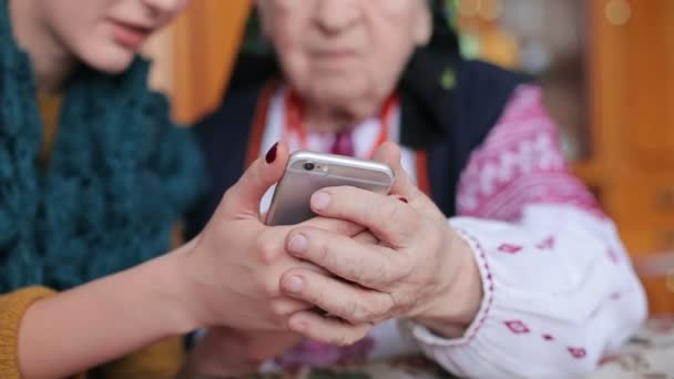 grandmother looking at mobile phone