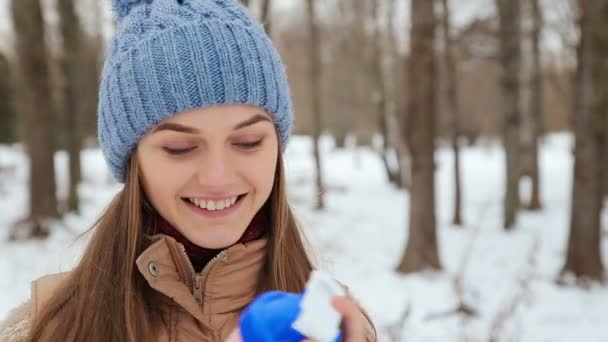 Girl uses protein in the park in winter