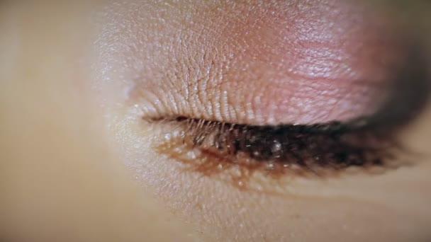 Painted eye beautiful girl. Close-up