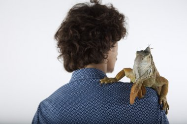 young man with iguana on shoulder